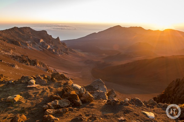 The sun rising above the crater of the Haleakala volcano (3055m)