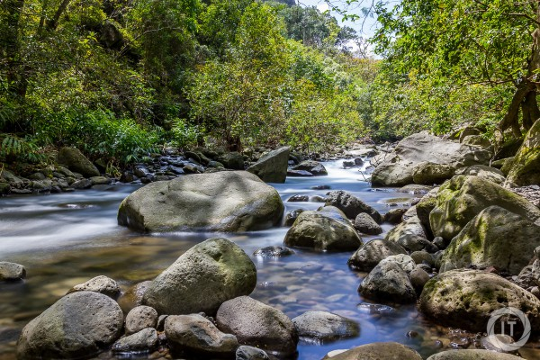 Long exposure of boulders poking through the Iao Stream on Maui