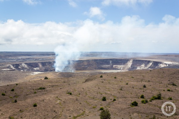 A shot of the crater of the active Kilauea volcano, fumes rising from the lava lake