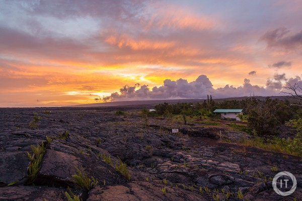 Sunset at Kalapana, which was covered in the last decades by lava flows, showing the fumes from the eastern Kileauea rift zone in the distance