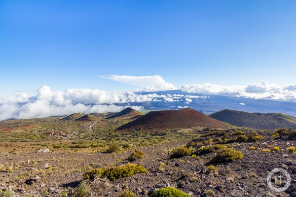 A view of Mauna Kea Visitor Center, with Mauna Loa in the background