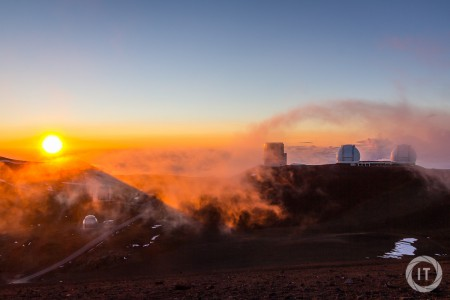 Sunset on the summit of Mauna Kea (4205m), showing the Subaru and Keck Telescopes, with fog rolling in
