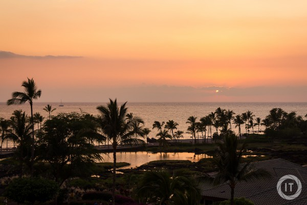 A view from our room over the fishponds and the beach of the Waikoloa Beach Marriott, during sunset