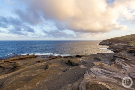 The sunset over Kahauloa Cove brings out the beautiful colors in the rocks, sea and sky