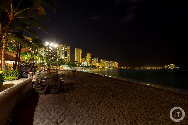 A view across Waikiki Beach by night