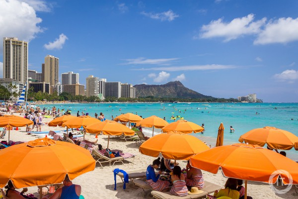 A view of the skyscrapers and tourists on Waikiki Beach, with Diamond Head in the background