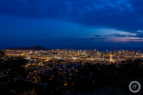 A view over Waikiki Beach at blue hour, from Round Top Forest Drive